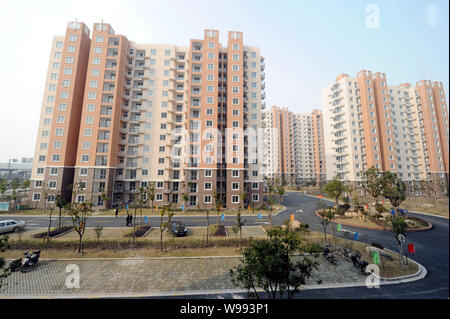 View of clusters of newly built low-income apartment buildings in Shanghai, China, March 3, 2011.   China will invest more than 1.3 trillion yuan ($19