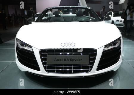 An Audi R8 is on display during an auto show in Hangzhou, east Chinas Zhejiang province, 13 October 2011.   German luxury carmaker Audi AG is on track - Stock Photo