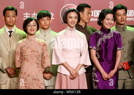 (Front from left) Chinese actresses Zhou Xun, Tang Wei and Ye Xuan are seen during a press conference for the movie, The Founding of the Party, in Bei