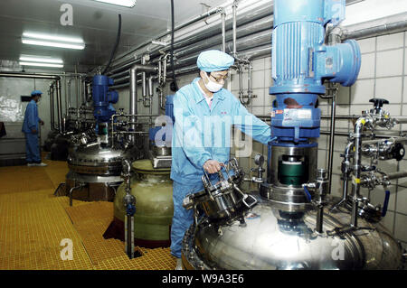 --FILE--Chinese workers monitor the production of medicine in the plant of Tianjin Shuangwei Biopharmaceutical Co., Ltd. in Tianjin, China, 12 Decembe - Stock Photo