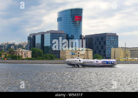 ST. PETERSBURG, RUSSIA - JULY 26, 2015: Hydrofoil ship Meteor on the Neva river against the backdrop of the 'St. Petersburg Plaza' business center on - Stock Photo