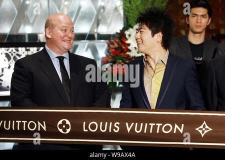ad8dbe809d4 Christopher Zanardi-Landi, left, CEO of Louis Vuitton China, talks ...