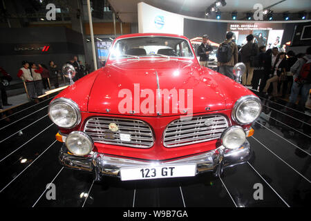 A Volvo 123 GT is seen on display during an auto show in Guangzhou city, south Chinas Guangdong Province, December 20, 2010.   Zhejiang Geely Holding - Stock Photo