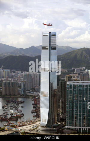 View of the International Commerce Centre (ICC) and clusters of office and residential apartment buildings in Hong Kong, China, August 12, 2010.   Sur - Stock Photo