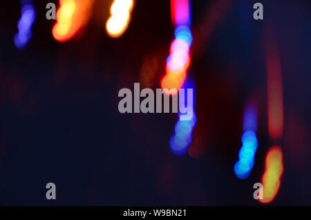 Multicolored defocused bokeh lights.  City winter night street blurred defocused background. Night winter blurred background. Winter Christmas time. - Stock Photo