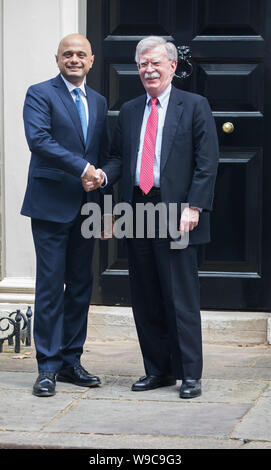 London, UK. 13th Aug, 2019. Chancellor of the Exchequer, Sajid Javid MP welcomes John Bolton, Trump's National Security Advisor on the doorsteps of Number 11 Downing Street. Credit: Keith Larby/Alamy Live News - Stock Photo