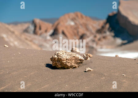 Sand dunes and geological rock formations of the Valley of the Moon (Valle de la Luna) in the Atacama Desert in Northern Chile - Stock Photo