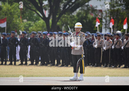 Banda Aceh, Indonesia - 17 August 2018: Troops raising the red and white flag at the celebration of Indonesia's independence day at Blang Padang. - Stock Photo