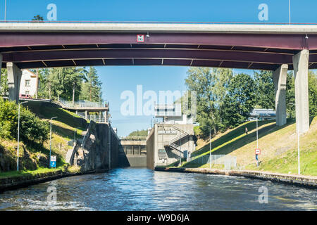 Lappeenranta, Finland - August 7, 2019: Lock and bridge on the Saimaa Canal at Malkia. View from water. - Stock Photo
