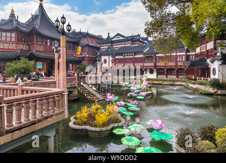 Yu Garden Pond in the Yu Garden Tourist Mart with the Huxinting Tea House to the left, Yuyuan Gardens, Old City, Shanghai, China - Stock Photo