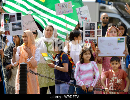 London, UK. 13th Aug, 2019. Kashmiri campaigners in Parliament Square, Westminster, protesting India's involvement in Kashmir, a week after the Modi Government revoked article 370, a constitutional provision granting the region special status-- Credit: PjrFoto/Alamy Live News - Stock Photo