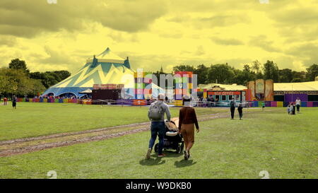 Edinburgh, Scotland, UK. 13th Aug, 2019. UK Weather: Sunny and cloudy as the weather turns changeable in the meadows area of Edinburgh as people picnicked and enjoyed the green space in the city centre as the circus visited for the festival. Credit: gerard ferry/Alamy Live News - Stock Photo