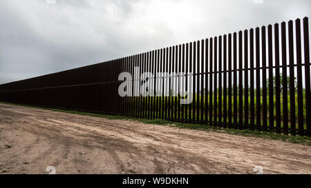 A portion of the high steel border wall, Brownsville, Texas, USA. - Stock Photo