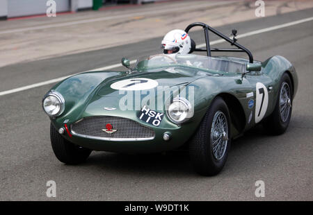 Wolfgang Friedrichs driving his 1954 Aston Martin DB3S down the National Pit lane during qualifying for the RAC Woodcote Trophy for Pre '56 Sportscars - Stock Photo