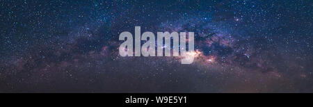 Panorama view universe space shot of milky way galaxy with stars on a night sky background.The Milky Way is the galaxy that contains our Solar System. Stock Photo