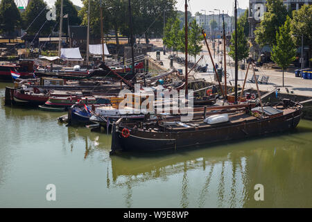 Rotterdam, Holland - July 30, 2019: Historical ships in the Oude Haven, Old Port, part of the Maritime District - Stock Photo