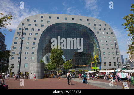 Rotterdam, Holland - July 30, 2019:  Markthal building at Saturday with the local market in front - Stock Photo