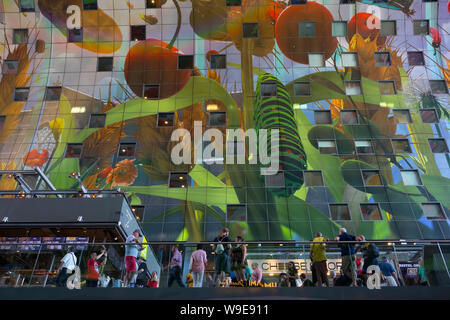 Rotterdam, Holland - July 30, 2019: Artwork at the wall of the Markthal, a residential and office building with a market hall underneath - Stock Photo