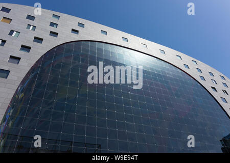 Rotterdam, Holland - July 30, 2019:  Facade of the Markthal building with glass windows - Stock Photo