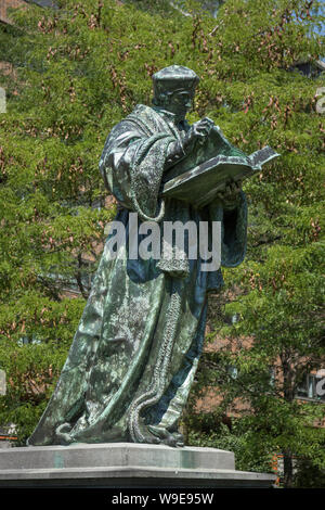 Rotterdam, Holland - July 30, 2019: Bronze statue of the Dutch Renaissance humanist Erasmus of Rotterdam at Grotekerkplein - Stock Photo