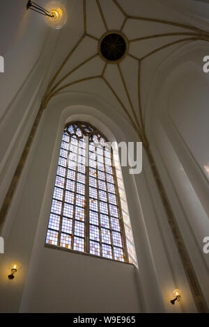 Rotterdam, Holland - July 30, 2019: Stained glass window in the entrance tower of the Lawrence church - Stock Photo