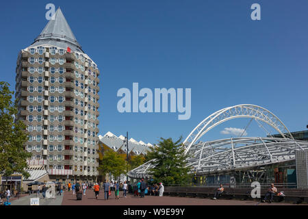 Rotterdam, Holland - July 30, 2019: Blaaktower, called the pencil, designed by architect Piet Blom and the Blaak train station - Stock Photo