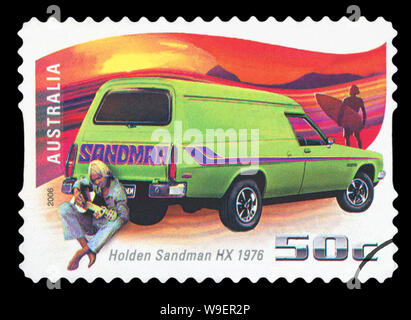 AUSTRALIA - CIRCA 2006: A stamp printed in Australia shows Holden Sandman HX - 1976 and man with guitar, circa 2006 - Stock Photo