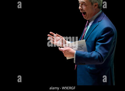 A portrait of a former UKIP and current Brexit party leader Nigel Farage giving a speech - Stock Photo