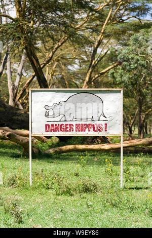 Danger hippos warning sign at lake Naivasha, Kenya, East Africa - Stock Photo