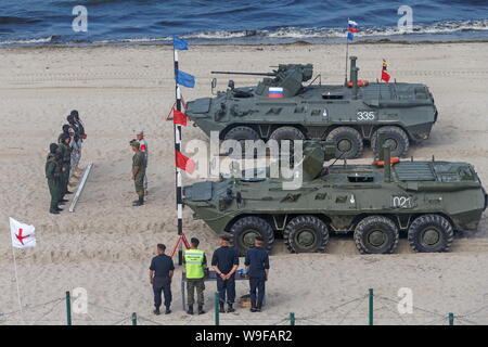 Russia. 13th Aug, 2019. KALININGRAD REGION, RUSSIA - AUGUST 13, 2019: A combat vehicle relay race at the Seaborne Assault Ñontest of the 2019 International Army Games, at Khmelevka, Kaliningrad Region. Vadim Savitsky/Press Office of the Ministry of Defence of the Russian Federation/TASS Credit: ITAR-TASS News Agency/Alamy Live News - Stock Photo