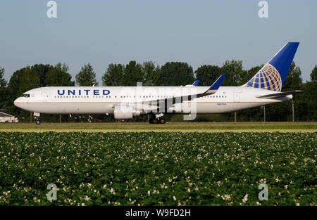 AMSTERDAM / NETHERLANDS - JULY 3, 2017: United Airlines Boeing 767-300 N657UA passenger plane taxiing at Amsterdam Schipol Airport - Stock Photo