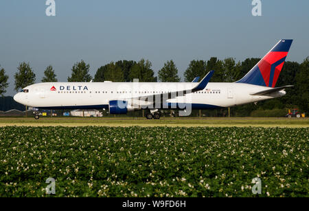 AMSTERDAM / NETHERLANDS - JULY 3, 2017: Delta Airlines Boeing 767-300 N197DN passenger plane taxiing at Amsterdam Schipol Airport - Stock Photo