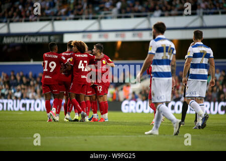 London, UK. 13th Aug, 2019. Jack Hunt of Bristol City celebrates with teammates after scoring his team's second goal during Carabao cup, EFL Cup 1st round match, Queens Park Rangers v Bristol City at The Kiyan Prince Foundation Stadium, Loftus Road in London on Tuesday 13th August 2019. this image may only be used for Editorial purposes. Editorial use only, license required for commercial use. No use in betting, games or a single club/league/player publications. pic by Tom Smeeth/Andrew Orchard sports photography/Alamy Live news Credit: Andrew Orchard sports photography/Alamy Live News - Stock Photo