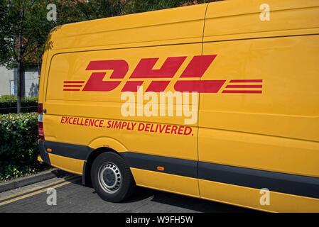 DHL deliovery van parked on a street in Edinburgh, Scotland, UK. - Stock Photo