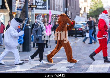 Men in fancy dresses crossing the zebra crossing, imitating Beatles, in London, England, UK - Stock Photo