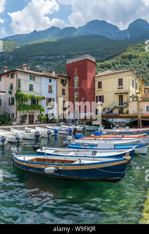 Cassone, Italy - 31 July, 2019 : This is fishing boats in Cassone harbour on Lake Garda in Italy - Stock Photo