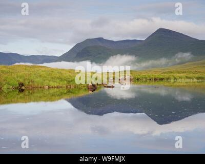 Morning reflections of Meall a'Bhuirdh in the still waters of Lochan Na Stainge on Rannoch Moor