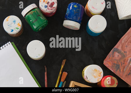 Painting artist desktop in the studio. Some paintbrushes and material ready for an art lesson in a classroom. Empty copy space for Editor's text. - Stock Photo