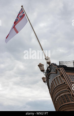 The white ensign flying above the stern of HMS Victory, Lord Nelsons Flagship From the battle of Trafalgar - Stock Photo