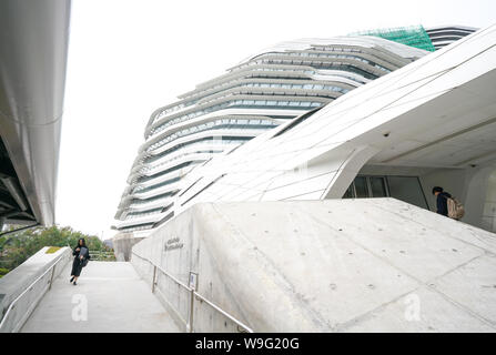 Hong Kong-15th March 2018: The Polyu School of Design Jockey Club Innovation Tower in Hong Kong. It's designed by Zaha Hadid. - Stock Photo