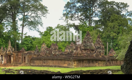 wide view of the ruins of banteay srei temple in angkor - Stock Photo