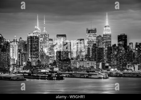 West New York City midtown Manhattan skyline view from Boulevard East Old Glory Park over Hudson River at dusk. - Stock Photo
