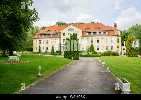 Neuhardenberg, Germany - May 29, 2019: Wulkow Castle in Neuhardenberg, Germany. It was during the time of the GDR a hospital, today it is used as a ca