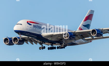 British Airways Airbus A380-8 landing at Vancouver Intl. Airport on a clear evening. - Stock Photo