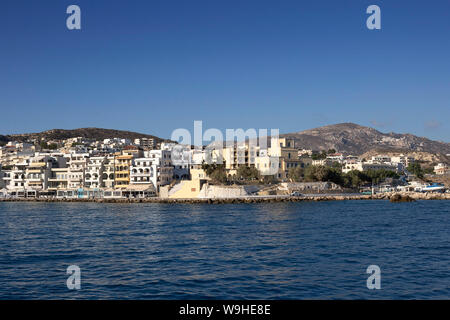 Karpathos island - The seafront of Pigadia village in summer day, Aegean sea, Dodecanese Islands, Greece - Stock Photo