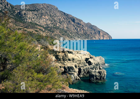 Karpathos island - Vananda coast, beautiful bay surrounded by a pine forest, Aegean sea, Dodecanese Islands, Greece - Stock Photo