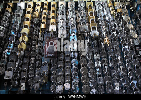 Assorted locks at a store, India - Stock Photo