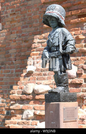 Warsaw Poland statue of the Little Insurgent in honour of the child soldiers who supported the Home Army during the Warsaw Uprising in August 1944 - Stock Photo