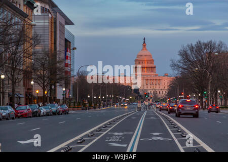 View of the setting sun on the Capitol Building from Pennsylvania Avenue, Washington DC, District of Columbia, United States of America - Stock Photo