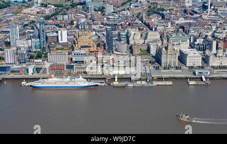 A Fred Olsen line Cruise ship, Black Watch and the Dazzle Mersey Ferry shot from the air, Liverpool, waterfront, North West England, UK
